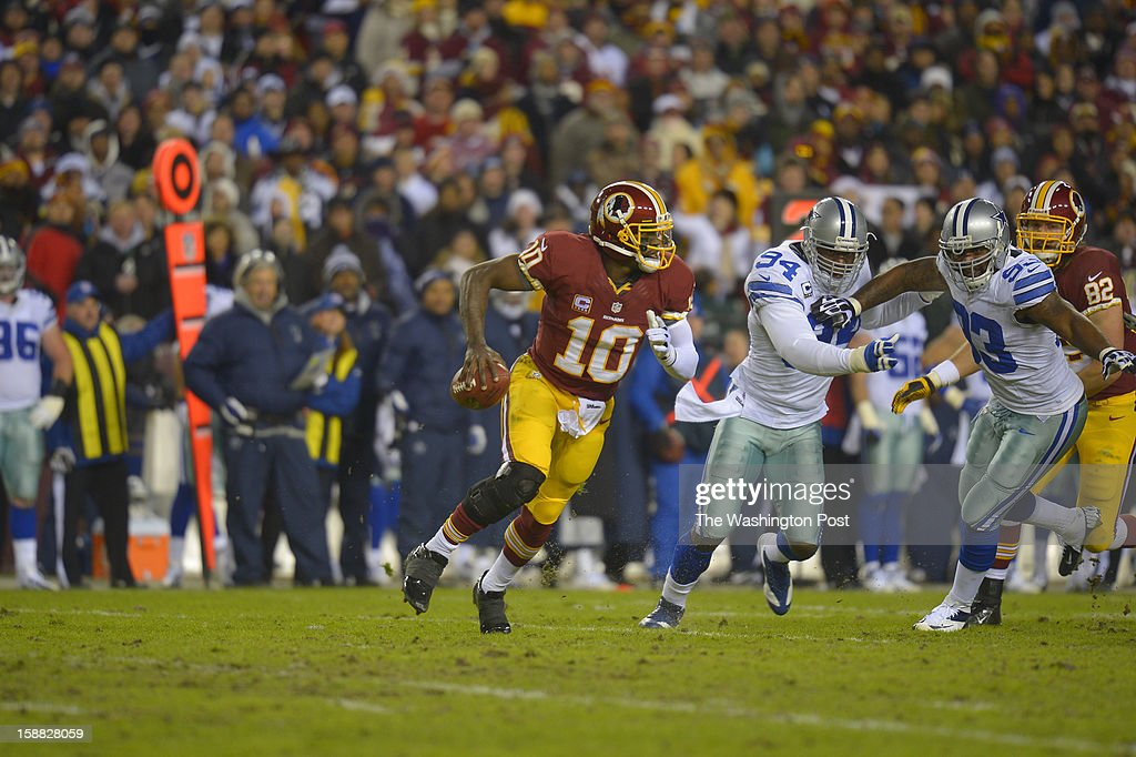Washington quarterback Robert Griffin III (10) scrambles in the first quarter as the Washington Redskins play the Dallas Cowboys for first place of the NFC East division and a playoff spot at FedEx in Landover MD, December 30, 2012 .