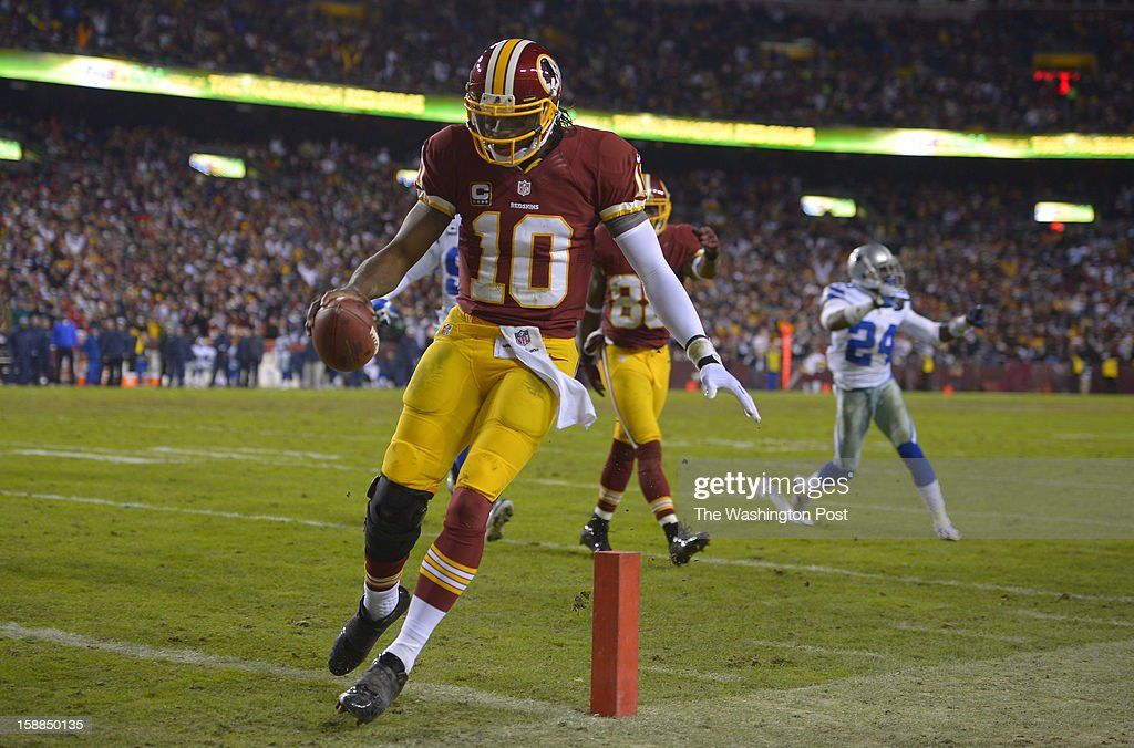 Washington quarterback Robert Griffin III (10) steps into the endzone and a third quarter touchdown as the Washington Redskins play the Dallas Cowboys for first place of the NFC East division and a playoff spot at FedEx in Landover MD, December 30, 2012 .
