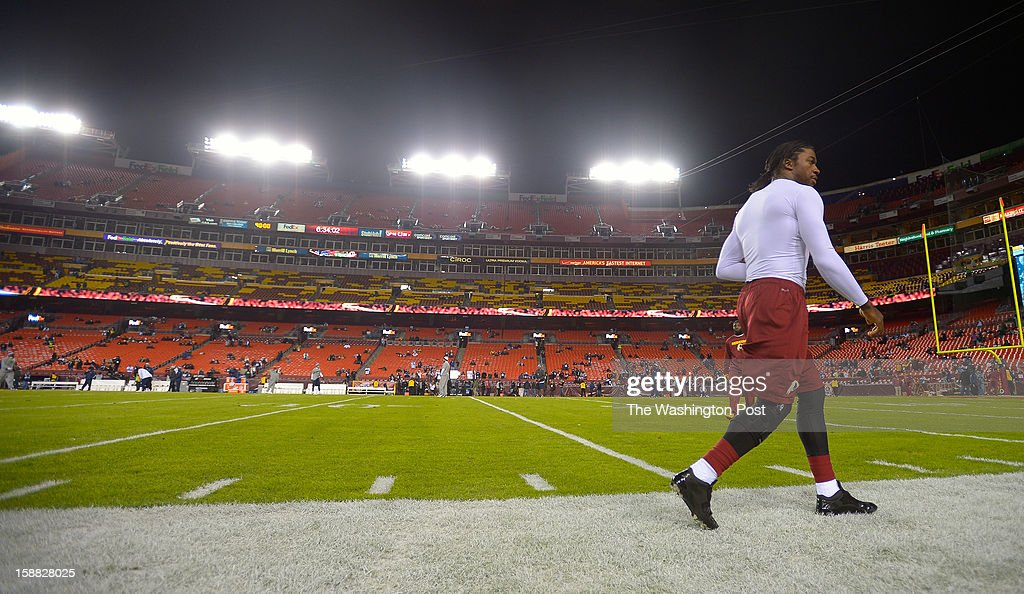 Washington quarterback Robert Griffin III (10) walks the perimeter of the field a couple of hours before the Washington Redskins play the Dallas Cowboys for first place of the NFC East division and a playoff spot at FedEx in Landover MD, December 30, 2012 .