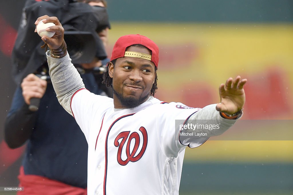 Washington Redskin football player Josh Norman throws out the first pitch before a baseball game between the Washington Nationals and the Philadelphia Phillies at Nationals Park on April 28, 2016 in Washington, D.C.