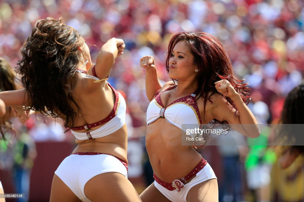 Washington Redskins cheerleaders perform during the Redskins game against the Jacksonville Jaguars at FedExField on September 14 2014 in Landover...