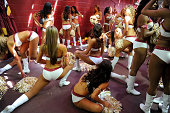 Washington Redskins cheerleaders stretch out before dancing during an NFL game between the Jacksonville Jaguars and the Washington Redskins at...