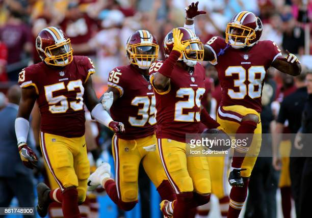 Washington Redskins cornerback Kendall Fuller celebrates with his teammates after getting a game sealing interception during a match between the...