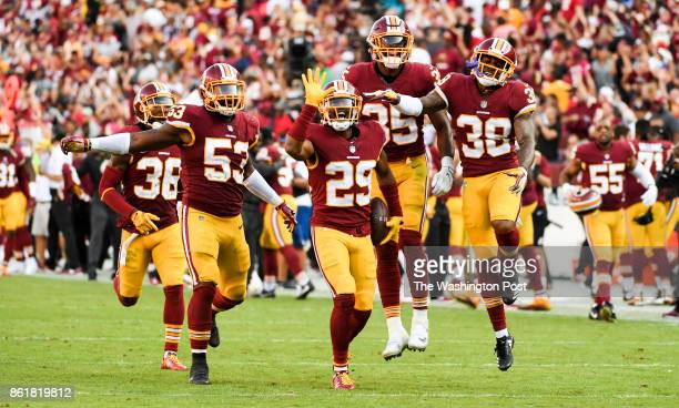 Washington Redskins cornerback Kendall Fuller celebrates with his teammates after he intercepted a pass by San Francisco 49ers quarterback CJ...