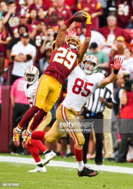 Washington Redskins cornerback Kendall Fuller intercepts a pass by San Francisco 49ers quarterback CJ Beathard intended for tight end George Kittle...