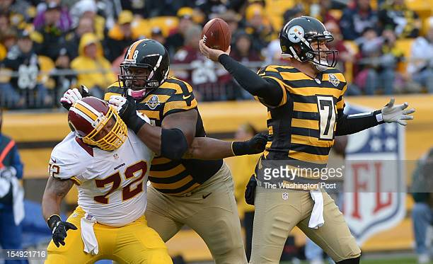 Washington Redskins defensive end Stephen Bowen reaches for Pittsburgh Steelers quarterback Ben Roethlisberger with tackle Max Starks on his back...