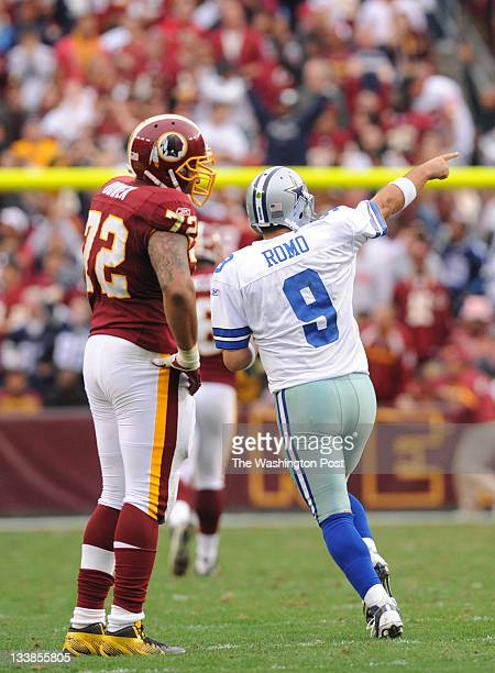 Washington Redskins defensive end Stephen Bowen stands with his hands on his hips as Dallas Cowboys quarterback Tony Romo celebrates a touchdown pass...