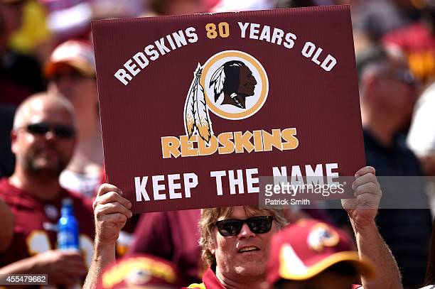 Washington Redskins fan holds up a sign to keep the Redskins name before they play the Jacksonville Jaguars at FedExField on September 14 2014 in...