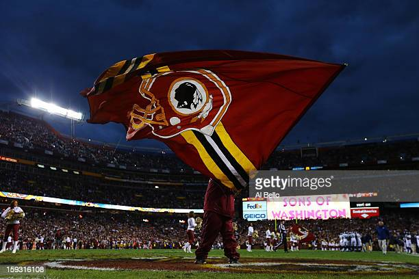 Washington Redskins flag is waved prior to the NFC Wild Card Playoff Game against the Seattle Seahawks at FedExField on January 6 2013 in Landover...