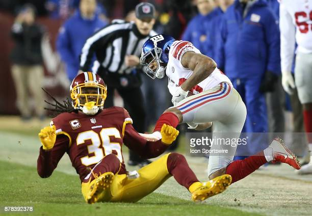 Washington Redskins free safety DJ Swearinger crashes New York Giants wide receiver Roger Lewis out of bounds with a hard tackle during a NFL game...
