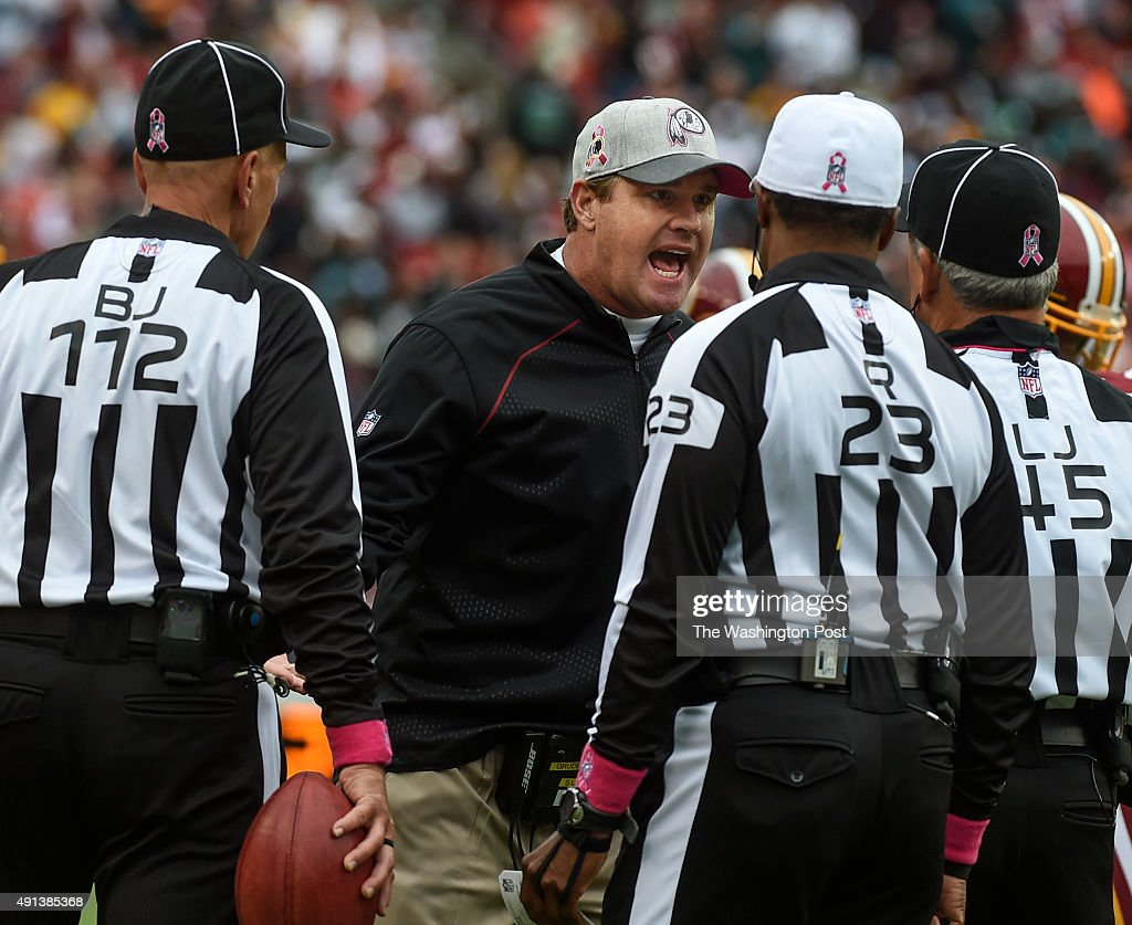 Washington Redskins head coach Jay Gruden argues with the referees over the fuel call at the end of the third quarter of the game between the...
