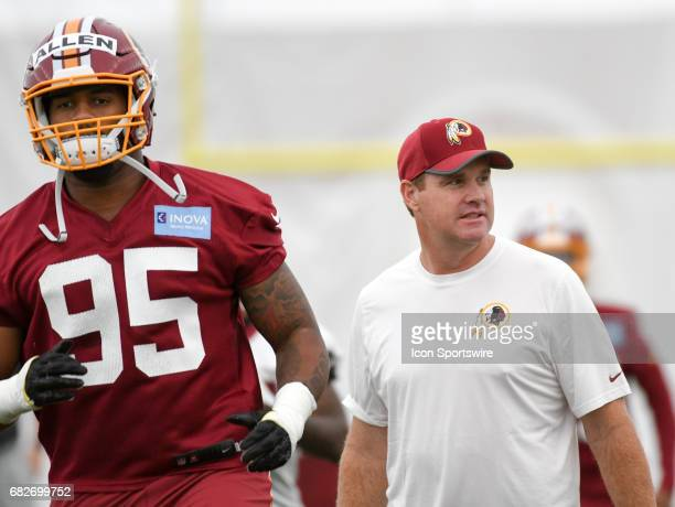 Washington Redskins head coach Jay Gruden participates with first round pick defensive lineman Jonathan Allen in the the Redskins rookie minicamp on...