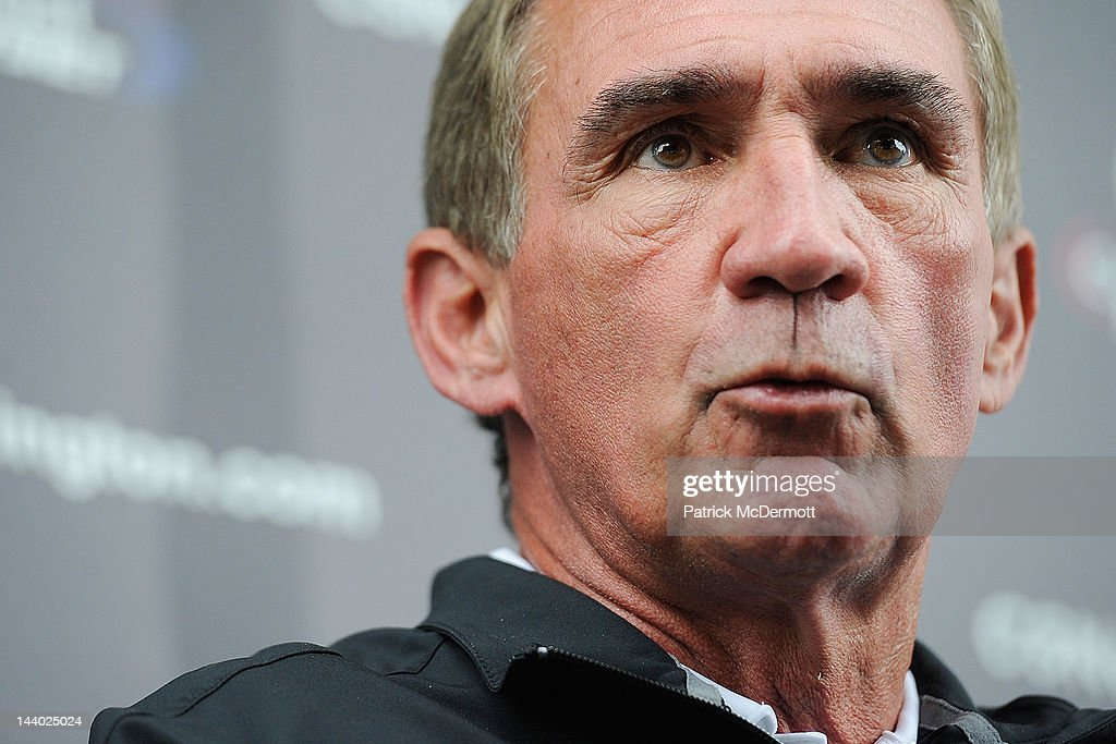 Washington Redskins head coach Mike Shanahan speaks to members of the media after a practice during the Washington Redskins rookie minicamp on May 6, 2012 in Ashburn, Virginia.