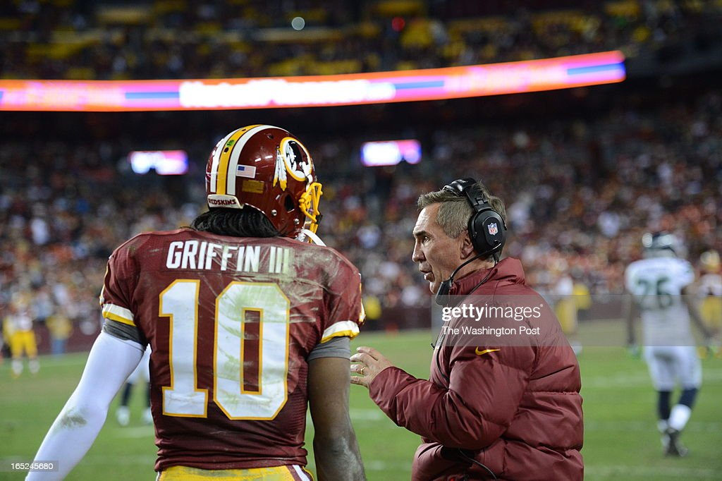Washington Redskins head coach Mike Shanahan talks with Washington Redskins quarterback Robert Griffin III (10) on the sidelines in the second quarter of the first round NFC playoff game between the Washington Redskins and the Seattle Seahawks at FedEd Field in Landover, Md., on Sunday, January 6, 2013.