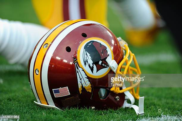Washington Redskins helmet sits on the grass during a preseason football game between the Redskins and Cleveland Browns at FedExField on August 18...