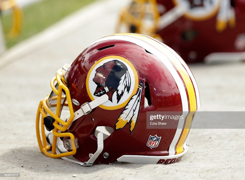 Washington Redskins helmets lay on the ground during their game against the Oakland Raiders at Oco Coliseum on September 29 2013 in Oakland California
