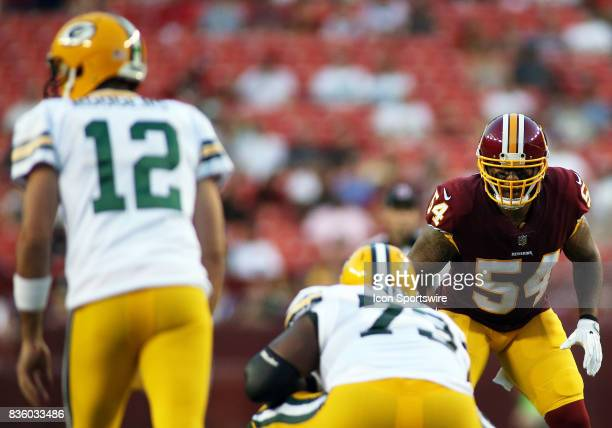 Washington Redskins inside linebacker Mason Foster stares down Green Bay Packers quarterback Aaron Rodgers during a match between the Washington...
