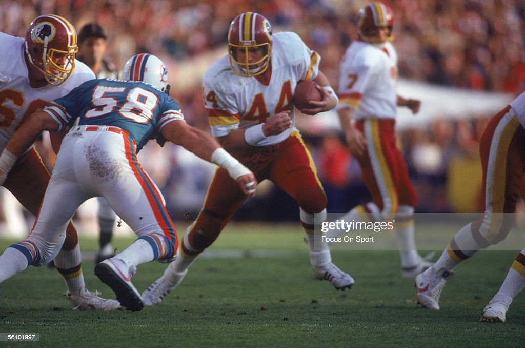 Washington Redskins' John Riggins runs the ball into the Miami Dolphins' defence during Super Bowl XVII at the Rose Bowl on January 30 1983 in...