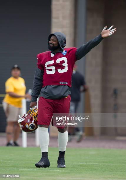 Washington Redskins linebacker Zach Brown waves onto the field prior to practice during day one of Redskins training camp at Bon Secours Training...