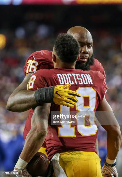 Washington Redskins offensive tackle Morgan Moses with wide receiver Josh Doctson after Doctson's touchdown in the fourth quarter during a NFL game...