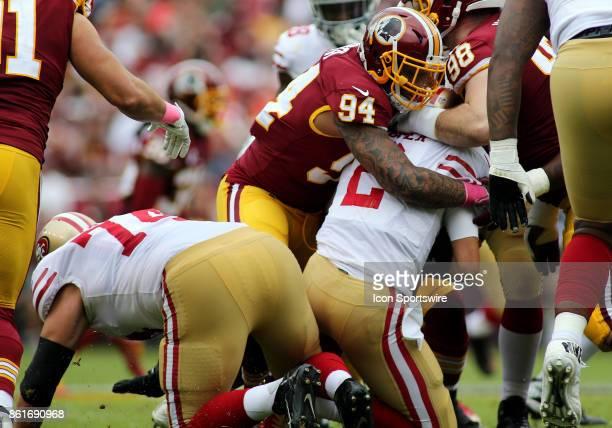 Washington Redskins outside linebacker Preston Smith takes down San Francisco 49ers quarterback Brian Hoyer for a sack during a match between the...