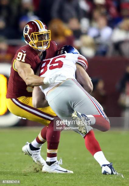 Washington Redskins outside linebacker Ryan Kerrigan holds up New York Giants tight end Rhett Ellison during a NFL game between the Washington...