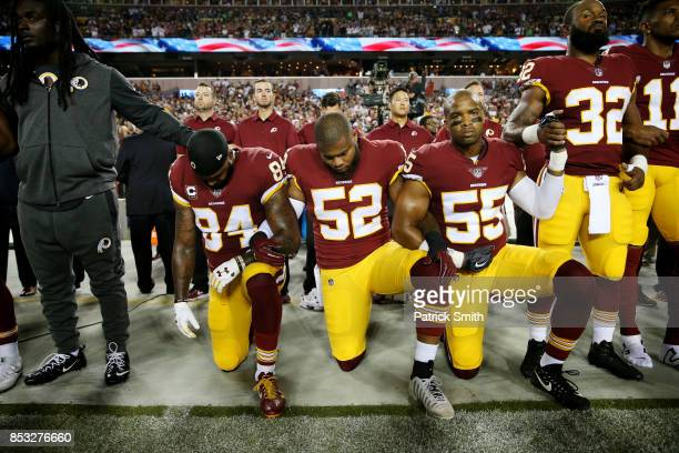 Washington Redskins players during the the national anthem before the game against the Oakland Raiders at FedExField on September 24 2017 in Landover...