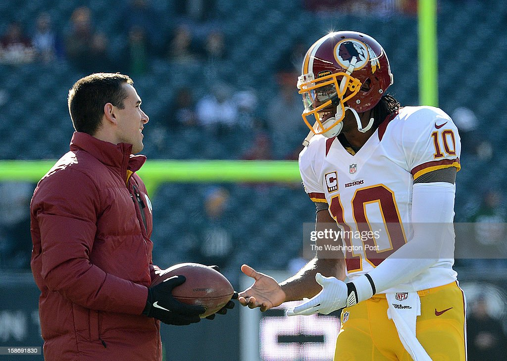 Washington Redskins quarterback coach Matt LaFleur, left, and Washington Redskins quarterback Robert Griffin III (10) share a laugh before the game between the Washington Redskins and the Philadelphia Eagles at Lincoln Financial Stadium in Philadelphia, Pa. on Sunday, December 23, 2012.