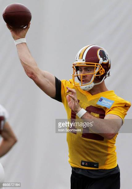 Washington Redskins quarterback Colt McCoy in action during an OTA practice session on June 07 at Inova Sports Performance Center at Redskins Park in...