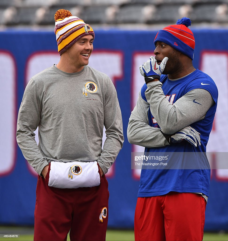 Washington Redskins quarterback <a gi-track='captionPersonalityLinkClicked' href=/galleries/search?phrase=Colt+McCoy&family=editorial&specificpeople=2701586 ng-click='$event.stopPropagation()'>Colt McCoy</a> (16) left, and New York Giants running back <a gi-track='captionPersonalityLinkClicked' href=/galleries/search?phrase=Chris+Ogbonnaya&family=editorial&specificpeople=2168653 ng-click='$event.stopPropagation()'>Chris Ogbonnaya</a> (47) chat before the game between the Washington Redskins and New York Giants at MetLife Stadium on December 14, 2014 in East Rutherford, NJ.