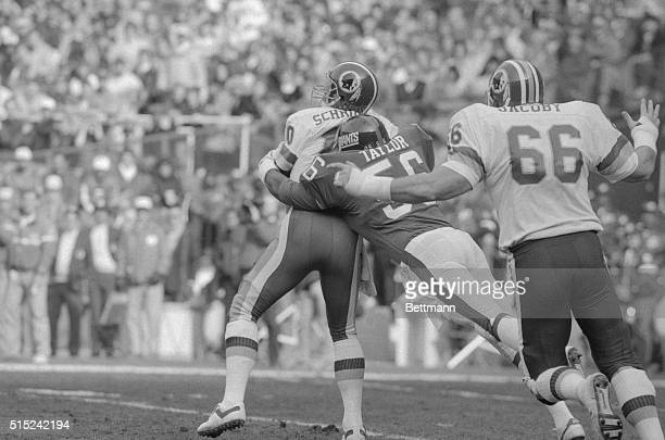Washington Redskins quarterback Jay Schroeder is sacked here by New York Giant's linebacker Lawrence Taylor causing a fumble that the Redskin's...