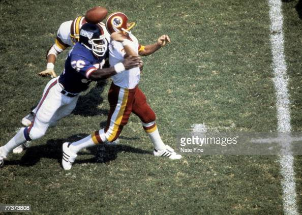 Washington Redskins quarterback Joe Theismann fumbles after being hit by Giants Hall of Fame linebacker Lawrence Taylor during the Redskins 177 loss...