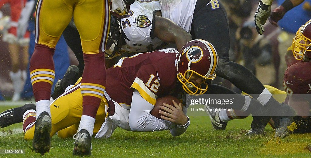 Washington Redskins quarterback Kirk Cousins (12) dives for a touchdown for a two point conversion forcing overtime during a game between the Baltimore Ravens and Washington Redskins at FedEx Field on December 9, 2012 in Landover, Md. Washington beat Baltimore 31-28.