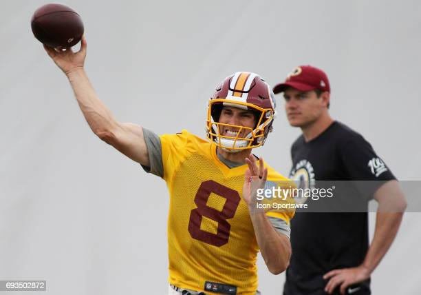 Washington Redskins quarterback Kirk Cousins in action during an OTA practice session on June 07 at Inova Sports Performance Center at Redskins Park...