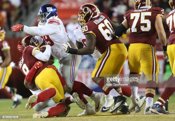 Washington Redskins quarterback Kirk Cousins is sacked by New York Giants defensive end Olivier Vernon and nose tackle Robert Thomas during a NFL...