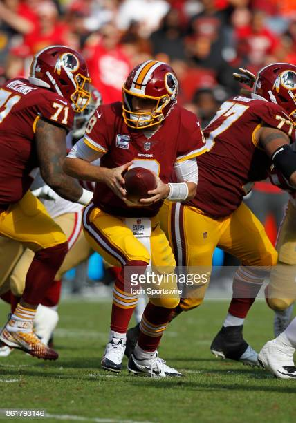 Washington Redskins quarterback Kirk Cousins prepares to hand the ball off during a football game between the San Francisco 49ers and Washington...