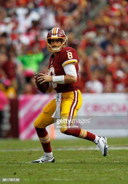Washington Redskins quarterback Kirk Cousins surveys the field looking to pass from the pocket during a football game between the San Francisco 49ers...