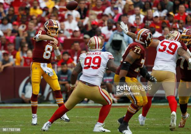 Washington Redskins quarterback Kirk Cousins throws a pass from the pocket during a football game between the San Francisco 49ers and Washington...