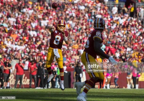 Washington Redskins quarterback Kirk Cousins throws a pass from the pocker to tight end Vernon Davis during a football game between the San Francisco...