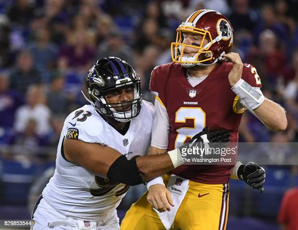 BALTIMORE MD AUGUST Washington Redskins quarterback Nate Sudfeld gets hits by Baltimore Ravens defensive end Chris Wormley as he throws an incomplete...