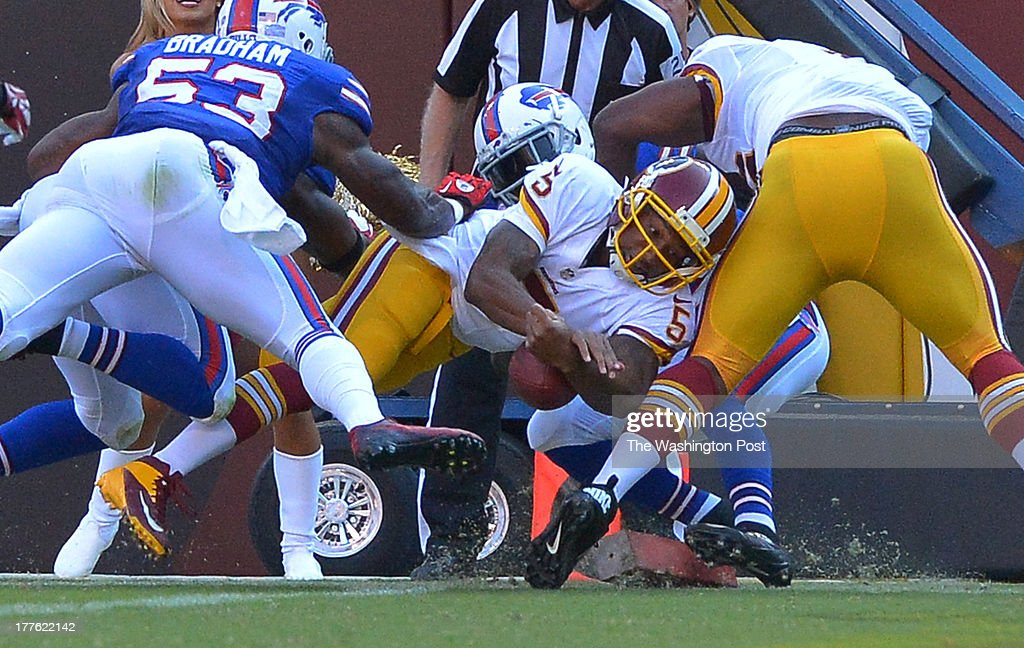 Washington Redskins quarterback Pat White (5) loses the football after scoring a touchdown in the second quarter during a preseason game between the Buffalo Bills and the Washington Redskins at FedEx Field on August 24, 2013 in Landover, Md.