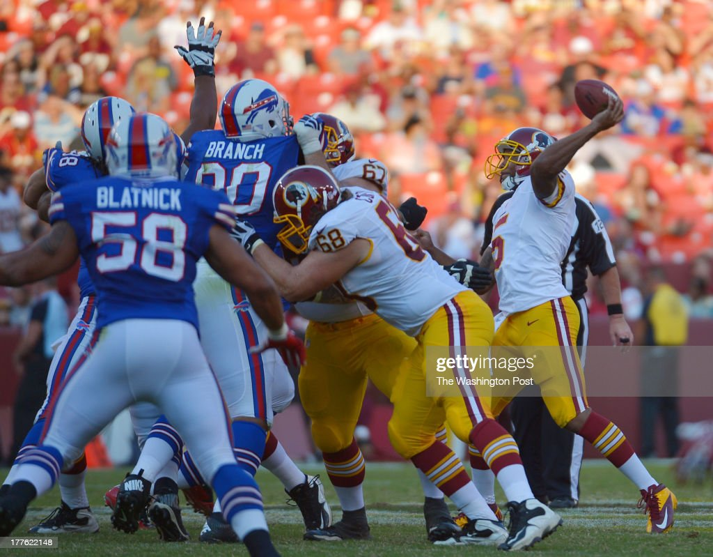 Washington Redskins quarterback Pat White (5) right, delivers a pass in the third quarter during a preseason game between the Buffalo Bills and the Washington Redskins at FedEx Field on August 24, 2013 in Landover, Md. Washington beat Buffalo 30-7.