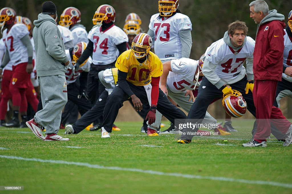 Washington Redskins quarterback RGII stretches alongside teammates at Redskins Park. RGIII suffered a knee injury during the game against the Baltimore Ravens. So far there have been no updates yet if he will play the Eagles on Sunday December 23rd.