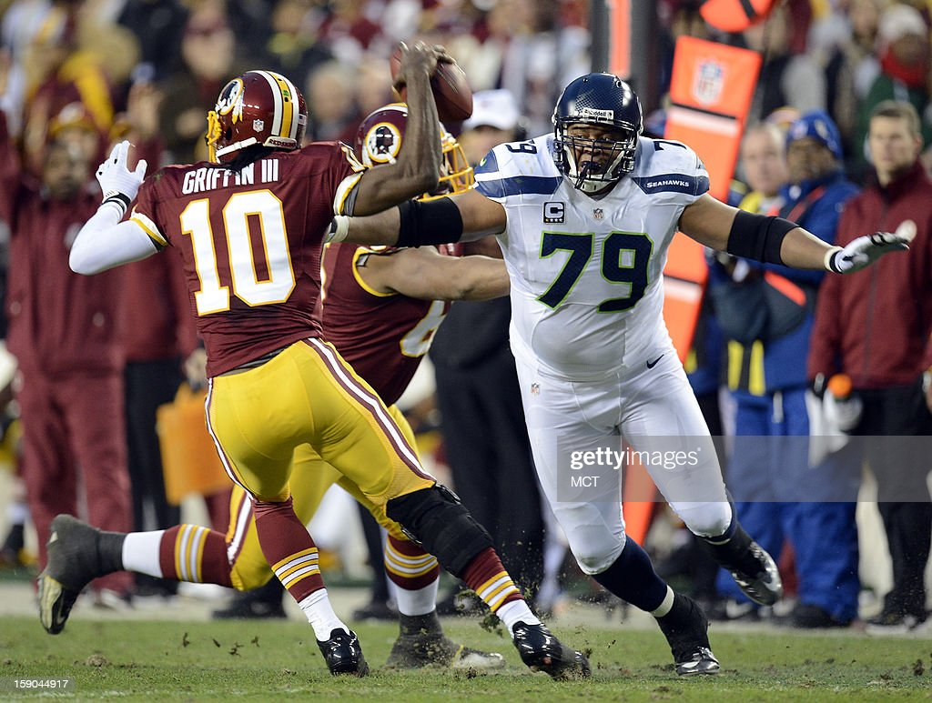 Washington Redskins quarterback Robert Griffin III (10) avoids the pressure from Seattle Seahawks defensive end Red Bryant (79) in the first quarter of an NFC wild-card playoff game at FedEx Field in Landover, Maryland, Sunday, January 6, 2013.