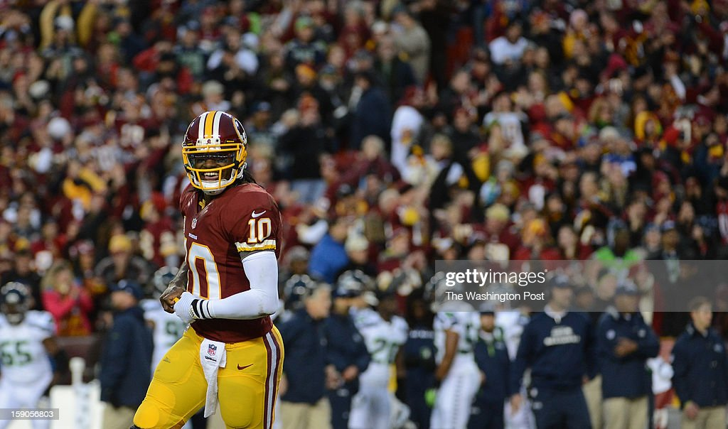 Washington Redskins quarterback Robert Griffin III (10) celebrates his touchdown pass early in the first quarter to make the score 7-0 Washington in the first round NFC playoff game between the Washington Redskins and the Seattle Seahawks at FedEd Field in Landover, Md., on Sunday, January 6, 2013.