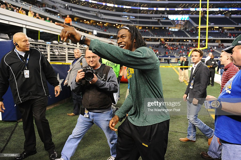 Washington Redskins quarterback Robert Griffin III (10) celebrates with the Baylor fans following the Bears overtime win over Texas Tech at Cowboys stadium on November. 24, 2012 in Arlington, TX