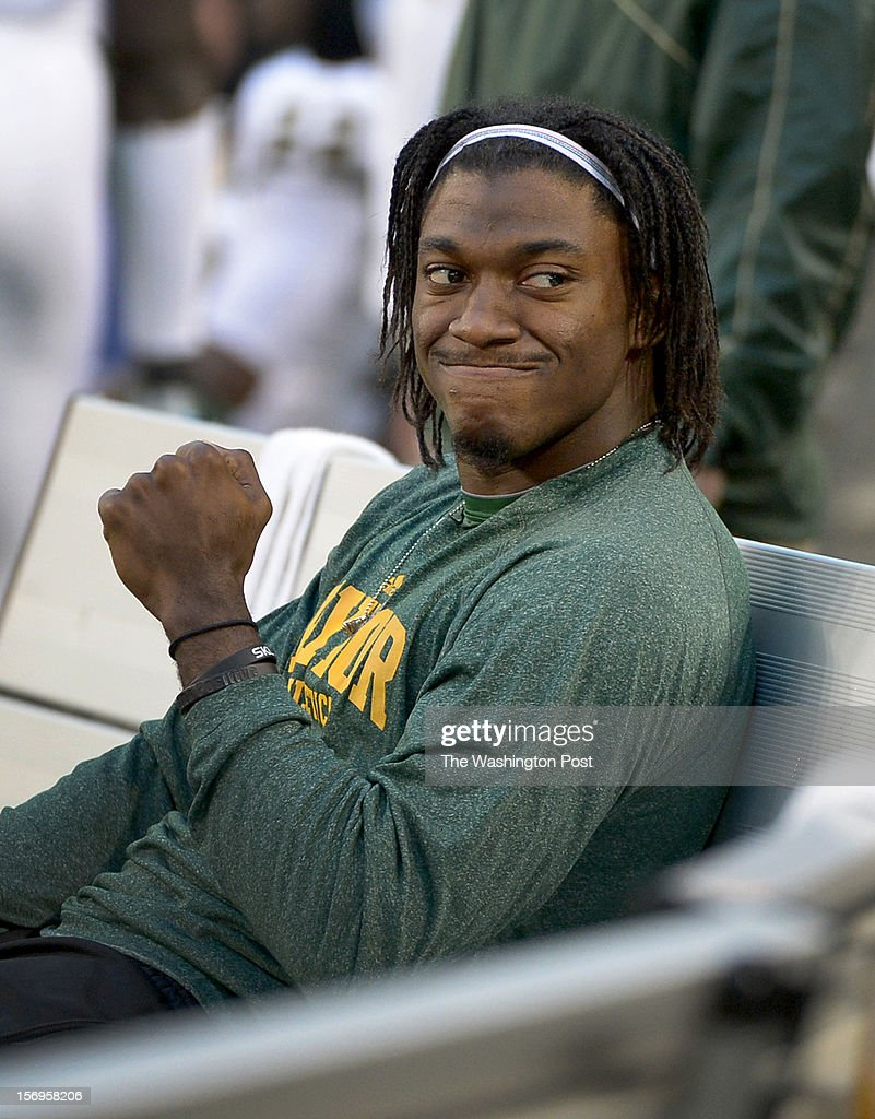 Washington Redskins quarterback Robert Griffin III (10) gives a little fist pump as the Baylor Bears rally against Texas Tech at Cowboys stadium on November. 24, 2012 in Arlington, TX
