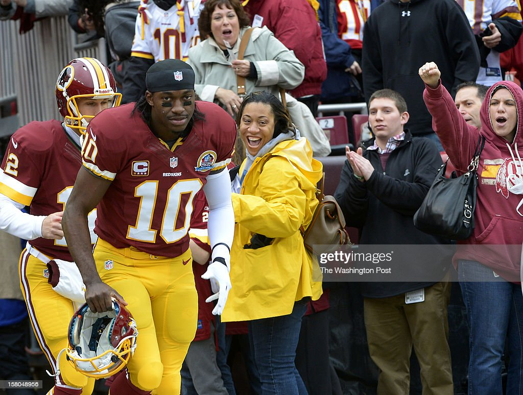 Washington Redskins quarterback Robert Griffin III (10) heads to the field for warm-ups before a game between the Baltimore Ravens and Washington Redskins at FedEx Field on December 9, 2012 in Landover, Md.