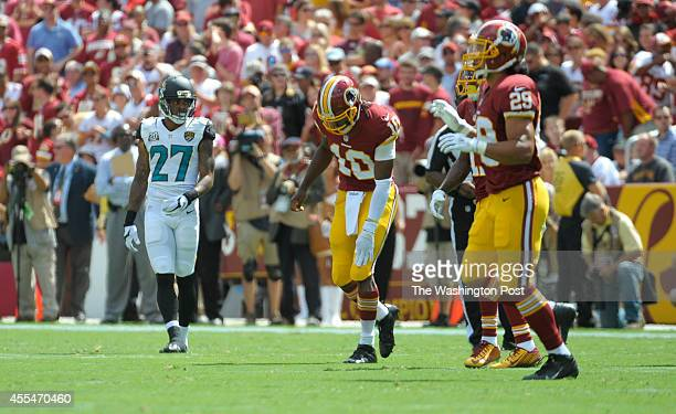 Washington Redskins quarterback Robert Griffin III holds his knee after running and sliding early in the first quarter against the Jacksonville...