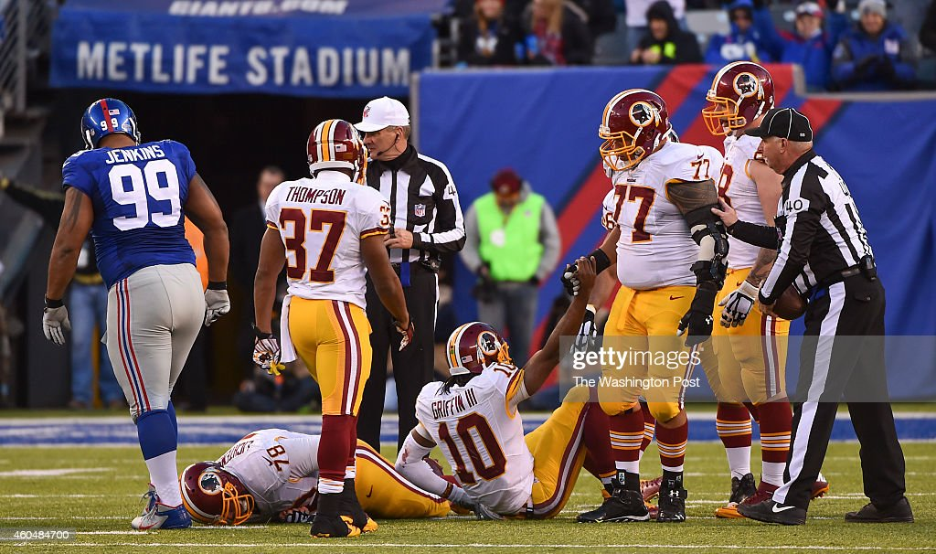 Washington Redskins quarterback <a gi-track='captionPersonalityLinkClicked' href=/galleries/search?phrase=Robert+Griffin&family=editorial&specificpeople=2495030 ng-click='$event.stopPropagation()'>Robert Griffin</a> III (10) is helped off the ground by teammate Washington Redskins guard <a gi-track='captionPersonalityLinkClicked' href=/galleries/search?phrase=Shawn+Lauvao&family=editorial&specificpeople=4629010 ng-click='$event.stopPropagation()'>Shawn Lauvao</a> (77) after being sacked by New York Giants defensive tackle <a gi-track='captionPersonalityLinkClicked' href=/galleries/search?phrase=Cullen+Jenkins&family=editorial&specificpeople=2096860 ng-click='$event.stopPropagation()'>Cullen Jenkins</a> (99) during the fourth quarter in a game between the Washington Redskins and New York Giants at MetLife Stadium on December 14, 2014 in East Rutherford, NJ. New York beat Washington 24-13.